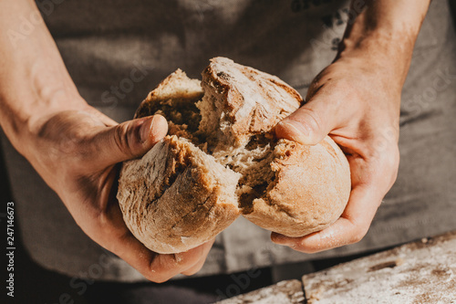Baker or chef holding fresh made bread Canvas Print