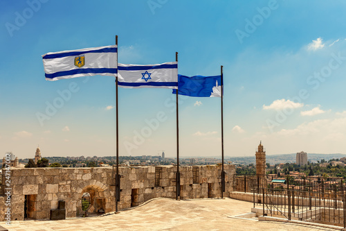 Photographie Three flags waiving on top of the citadel walls in Jerusalem.