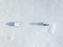 Aerial View Of Cottage In Snow...