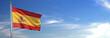 Leinwanddruck Bild - Bandera de España subida ondeando al viento con cielo de fondo
