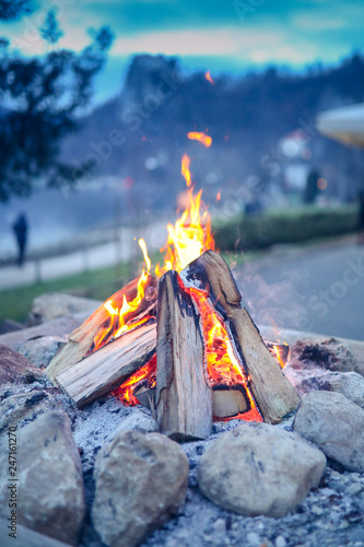 Photo Small camp fire with a pile of wood at Bled, Slovenia