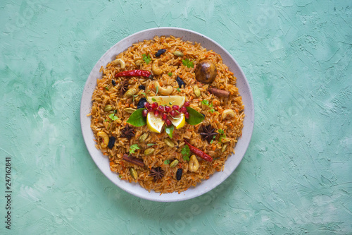 Homemade chicken Biryani. Arabic traditional food bowls Kabsa. Top view.