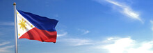 Flag Of Philippines Rise Waving To The Wind With Sky In The Background