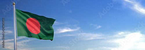 Foto Flag of Bangladesh rise waving to the wind with sky in the background