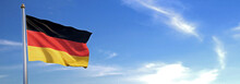 Flag Of Germany Rise Waving To The Wind With Sky In The Background