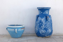 Jugs In Front Of A White Wall