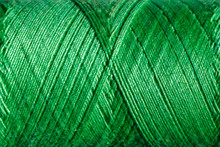 The Green Cotton Thread Is Tig...