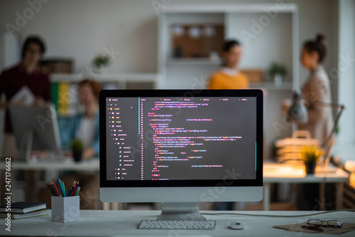 Fotografie, Obraz  Workplace of it-developer or programmer with computer screen with coded data on