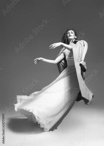 Valokuva  woman dancing classic dance in white dress on gray background