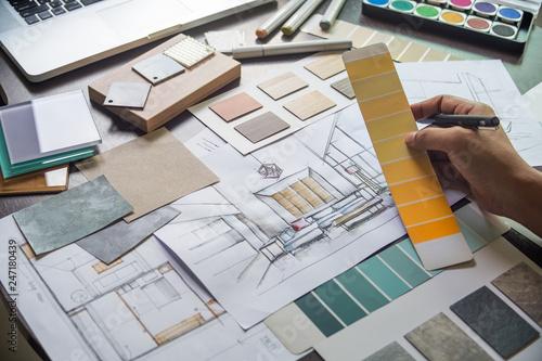 Obraz Architect designer Interior creative working hand drawing sketch plan blue print selection material color samples art tools Design Studio - fototapety do salonu