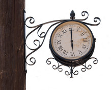 Vintage Street Clock On A Wooden Pole Isolated On White Background