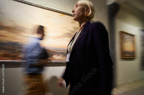 Blurred Shapes Of People Walking In Hall Of Modern Art