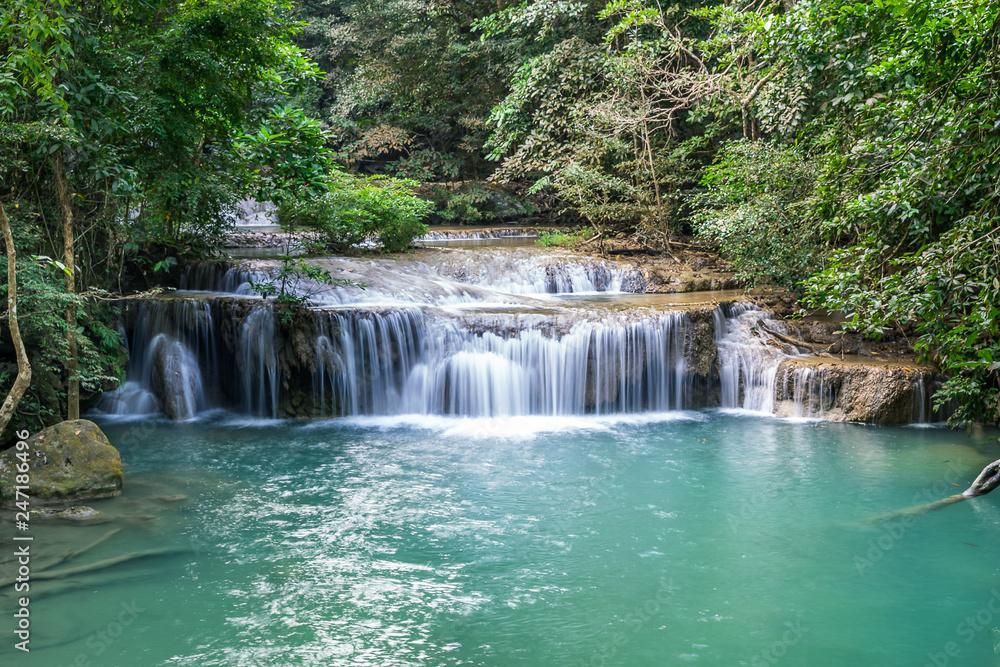 Erawan water fall, tropical rainforest at Srinakarin Dam, Kanchanaburi, Thailand.Erawan water fall is beautiful waterfall in Thailand. Unseen Thailand - Image