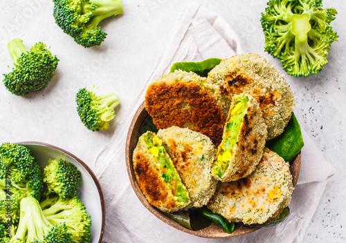 Fototapeta Green broccoli burgers in coconut shell dish on white background, top view. obraz