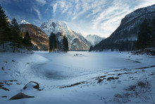 Frozen And Snow Covered In Winter Lago Del Predil Beautiful Alpine Lake In North Italy Near The Slovenian Border. Julian Alps Italy