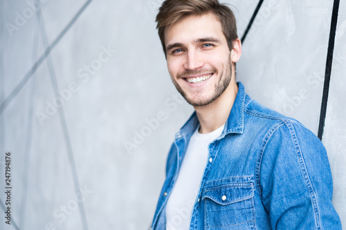 Perfect man. Portrait of happy fashionable handsome man in jeans shirt.