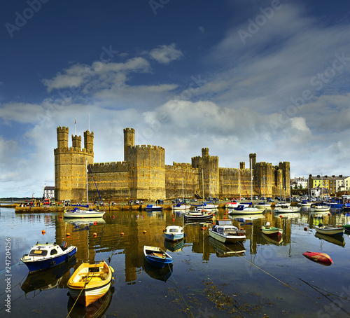 Wall Murals Northern Europe Caernarfon Castle, North Wales, UK. It belongs among Castles and Town Walls of King Edward in Gwynedd - UNESCO World Heritage site.