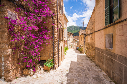Valldemossa beautifuls streets decorated in plant pots and colorful flowers