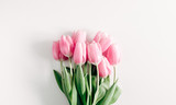 Fototapeta Tulipany - Flowers composition romantic. Pink flowers tulips on white background. Wedding. Birthday. Happy woman's day. Mothers Day. Valentine's Day. Flat lay, top view, copy space
