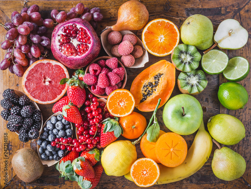 Fruits and berries top view.Natural vitamins and antioxidants food concept rainbow. Wall mural