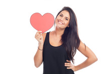 Beautiful Happy Brunette Woman Holding And Showing A Big Red Heart