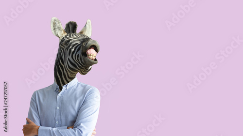Photo Stands Zebra Contemporary art collage. Funny laughing zebra head on human body in business shirt. Clip art, negative space.