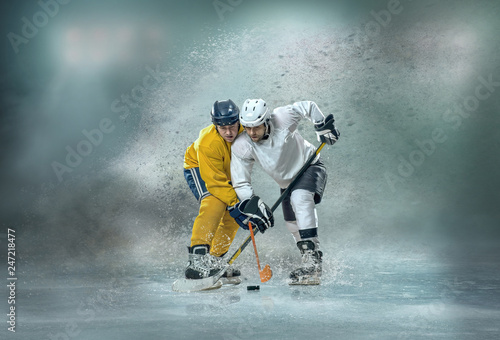 hockey fight, Ice hockey Players in dynamic action in a professional rink