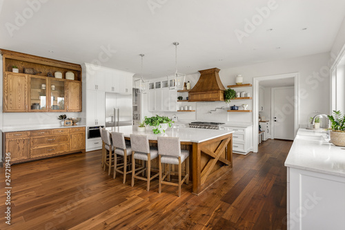 Photo  Beautiful Large Kitchen in New Home with Dark Hardwood Floors and Accents, and W