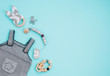 canvas print picture - Baby romper, soother and wooden toys on blue background