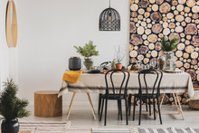 Forest Inspired Dining Room With Wooden Wallpaper And Stylish Black Chandelier