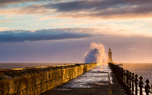 Stormy Sea Crashing Over Tynemouth Pier, Tyneside, Engalnd, UK . In Early Morning Light And Sunrise.