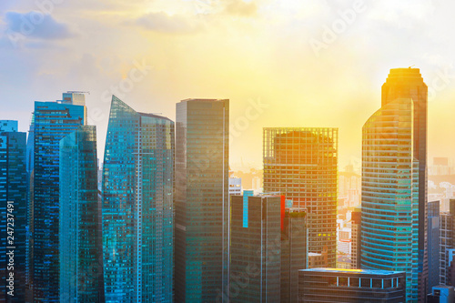 Foto op Canvas Aziatische Plekken Singapore skyscrapers in backlit sunset