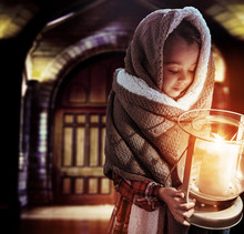 Conceptual Portrait Of A Cute Little Girl Holding A Torch