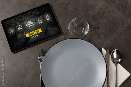 Online fast food order concept on a laid table