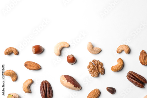 Composition with organic mixed nuts on white background, top view. Space for text
