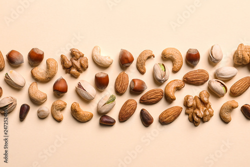 Flat lay composition with organic mixed nuts on color background