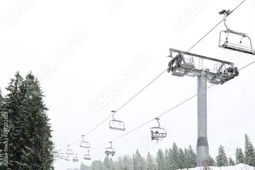 Ski lift at mountain resort. Winter vacation