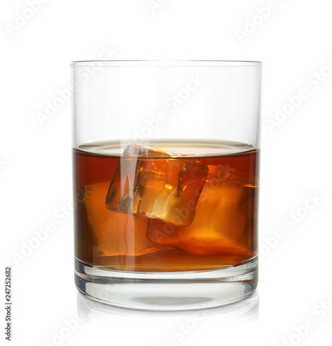Glass of scotch whiskey on white background