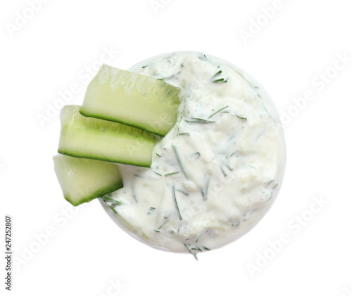 Bowl with cucumber sauce on white background, top view