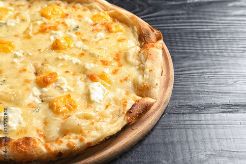 Hot cheese pizza Margherita on wooden table, closeup