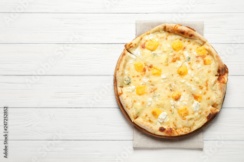Hot cheese pizza Margherita on white wooden background, top view. Space for text