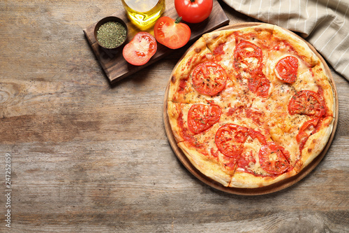 In de dag Aromatische Hot cheese pizza Margherita on wooden table, top view. Space for text