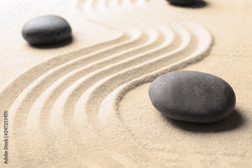 Photo  Zen garden stones on sand with pattern. Meditation and harmony
