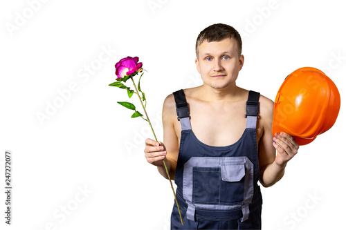 Fotografie, Obraz  A nice professional builder congratulates all women on March 8, International Women's Day