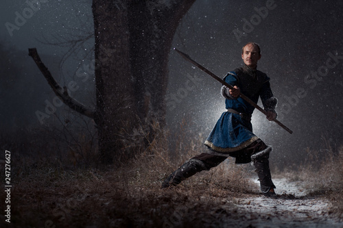 Medieval knight with sword in armor as style Game of Thrones in Winter Forest La Canvas Print