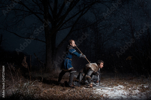 The battle between medieval knights in the style of Game of Thrones in winter forest landscapes Canvas Print