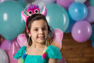 Girl child with balloons