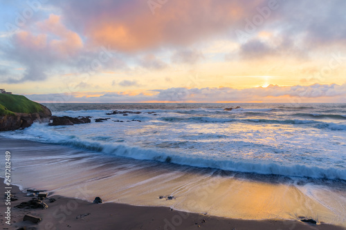 Vászonkép Pastel colors of sunset and silky water from long exposure of waves crashing by