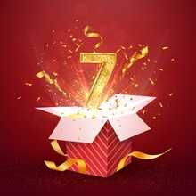 7 Th Year Number Anniversary And Open Gift Box With Explosions Confetti Isolated Design Element. Template Seven Seventh Birthday Celebration On Red Background Vector Illustration.