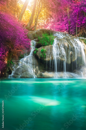 Tuinposter Watervallen Amazing in nature, beautiful waterfall at colorful autumn forest in fall season